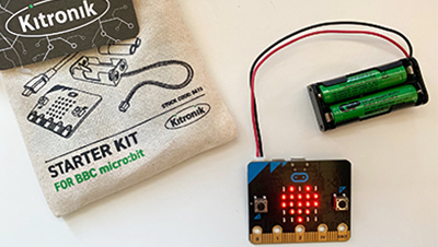 A heart is displayed on the BBC micro:bit